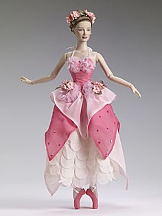 This is Spring Time Ballet with the Daphne Sculpt by Tonner. My listing at my Tias site has been updated with a photo of this doll in her box to show the coral in the deeper pink of this beautiful dolls shoes and ballet costume. She is Item TOB0016 at http://www.donnaskorner.com. I did not change the order of photos, but it is the last photo of this listing.