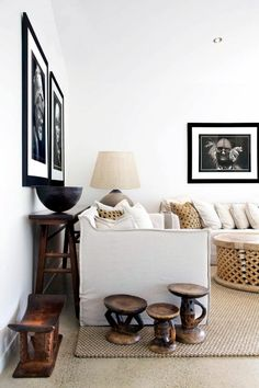 DM Idea - Thinking of how to connect your gallery and dining room, you could consider adding a touch of african style into the gallery with touches such as these wooden stools for example.