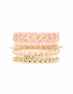 I really like these colors together - the light pink with gold. I used to hate gold, but it's growing on me again. Groups of bracelets like this - super like.