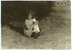 [Blind child making the acquaintance of a bit of statuary at Oklahoma School for the Blind. See Ellis report.] Location: [Muskogee, Oklahoma]