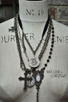 just lovely ... rosary, necklaces, medals