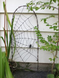 Spider Spinning A Web Barbed Wire Garden Trellis Made to Order. $59.00, via Etsy.