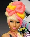 Looks like a giant pink dog tird on her head