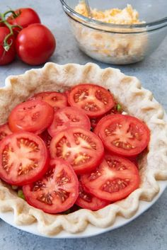 An image of a par-baked pie crust with layers of tomatoes green onions and basil for a southern tomato pie. An image of a par-baked pie crust with layers of tomatoes green onions and basil for a southern tomato pie. Summer Recipes, Great Recipes, Favorite Recipes, Delicious Recipes, Side Dish Recipes, Vegetable Recipes, Tomato Pie Recipes, Sweet Tomato Recipe, Tomato Pie Cafe Recipe