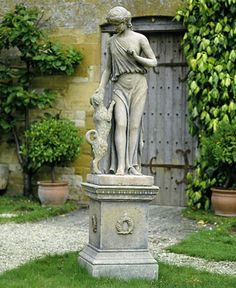 "Statue of Fidelity. Adaptation of the Roman Goddess, Fides. Shown with ""her dog, Fido, from antiquity a symbol of loyalty and faithfulness."" Drew Pritchard, antique dealer."