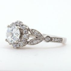 Vintage Floral Style Halo Engagement Ring - Lilly by Moissanite Rings. Shop now at https://www.moissaniterings.com!