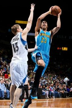 Young Anthony Davis of the New Orleans Hornets drives to the basket against Luke Ridnour of the Minnesota Timberwolves on March 17, 2013 in Minneapolis