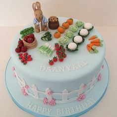 http://jojoscakes.com/what-i-do/kids-cakes/peter-rabbit-cake