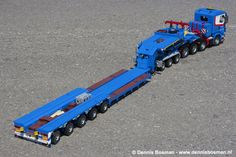 Scania R500 8x4/4 with large Belgian built Faymonville Megamax low loader. The rear deck has ten steered pendulum axles, the swing dolly a steered rear axle. The trailer consist of four sections; swing dolly, neck, loading deck, rear deck. The loading deck in extendible and then it can reach a total length of approx. 2.5 meters. The trailer itself has all details the real thing also has; the ramps, chains, braces etc. are put at the rear section or on top of the neck. It took me over tw...