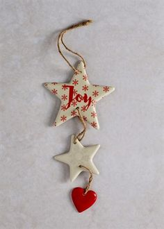 Ceramic hanging Christmas decoration in red and cream. Large star with snowflakes and 'Joy' text. Medium star with snowflake and small plain heart. Dimensions: The post Christmas Shop appeared first on Dekoration. Ceramic Christmas Decorations, Diy Christmas Ornaments, Xmas Decorations, Christmas Projects, Holiday Crafts, Christmas Quotes, Christmas Christmas, Salt Dough Decorations, Polymer Clay Ornaments