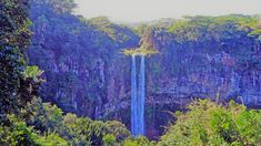 The magnificent Chamarel falls are definitely the most famous and recognized waterfalls in Mauritius and plunges more than in a single drop! Hindu Temple, Africa Travel, Mauritius, Waterfalls, Earth, Drop, Painting, Painting Art, Paintings