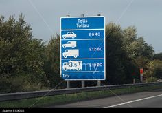 Stock Photo - Motorway toll signs on the for the Second Severn Bridge crossing in Wales Motorway Signs, Severn Bridge, Editorial Photography, Wales, Signage, Two By Two, Safety, Stock Photos, Blue