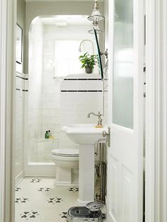 Small bathroom. Black striped tile