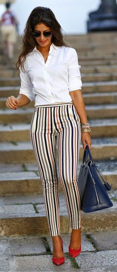 White shirt, striped pants, red heels, blue handbag and accessories.