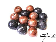 Faux Ceramics beads | Flickr - Photo Sharing! #beads #cuentas #polymerclay #arcillapolimérica #red #rojo #brown #marrón #negro #black #designersvenezuela #DiseñoVenezolano #VenezuelanDesign #handmade #hechoamano
