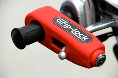 Grip-Lock (Red). Easy to Use, Hard to Defeat. Security lock for motorcycles, ATVs, snowmobiles and more.