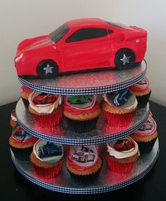Its not very often you get a cake with cupcakes, buts its certainly possible to do, like with this racing car cake & enough cupcakes for the little treasures coming to the party. racing car with cupcake tower birthday cake