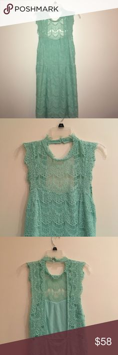 NWT Free People Daydream Lace Minidress size L NWT Free People Daydream Lace Minidress!  Size L!! Fluttery eyelash trim accents the sheer beauty of this scalloped lace minidress styled with a showstopping keyhole back. Back keyhole with double button-and-loop closure and Jewel neck.  Sleeveless and Partially line 60% cotton, 40% polyester Free People Dresses Mini