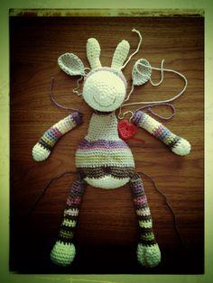 Adding a heart to my new friend!!! Giraffe amigurumi, pattern from ilovebuttonsbyemma