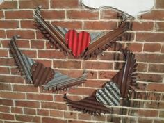 Kansas Barn Tin Heart with Wings Gypsy Junk Rusty bedroom wall decor home country by whattawaist on Etsy https://www.etsy.com/listing/220531779/kansas-barn-tin-heart-with-wings-gypsy