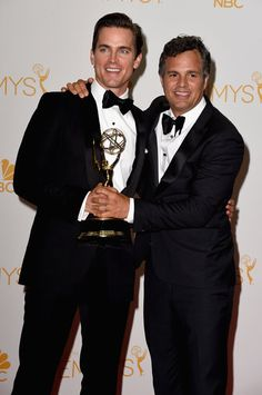 Must-See Moment: Actors Matt Bomer and Mark Ruffalo pose in the press room during the 66th Annual Primetime Emmy Awards.