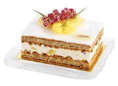 Le Noumea- Biscuit pâte macaron, noisettes, ananas frais poché à la vanille, crème légèrement parfumée à la banane et décoré d'une meringue à l'italienne.
