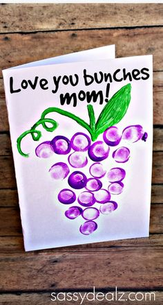 "Have your kids make this thumbprint grapes Mother's Day card for their moms! All you need is paint and a marker. At the top of the card it says ""love you bunches!"""