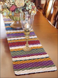 Rustic Basket Weave Table Runner  Bold stripes pair with a rich basket-weave texture for an easy-to-stitch tabletop accent with country appeal. This e-pattern was originally published in It's in the Bag.