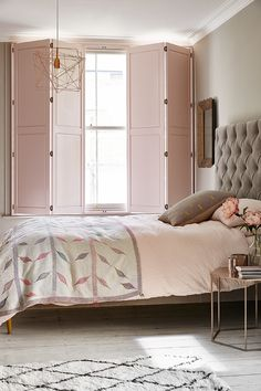 A modern luxe look for a bedroom, combine solid panel traditional shutters with soft pinks and a padded headboard. http://www.theshutterstore.com