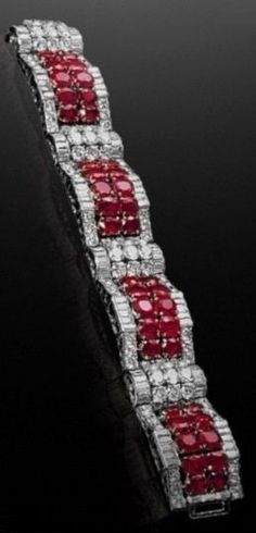 An Art Deco platinum, ruby and diamond bracelet, by Van Cleef & Arpels, circa Probably designed by René Lacaze, the bracelet was given to Wallis Simpson by Edward VIII a few months before his abdication. The clasp is engraved 'Hold Tight Wallis Simpson, Ruby Jewelry, Art Deco Jewelry, Modern Jewelry, Fine Jewelry, Geek Jewelry, Silver Jewelry, Edward Viii, Diamond Bracelets