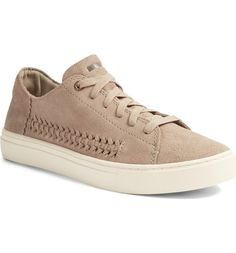 Chevron-embossed suede at the heel adds textural intrigue to this essential casual leather sneaker updated with a well-cushioned insole for all-day comfort.