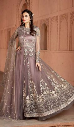 Light Purple Multi Embroidered Net Anarkali Suit is especially crafted for showcasing glamorous style and ethnic elegance with its unique embroidered combination of zari, thread and reshamkari embroidered on fancy net floor length anarkali gown Floor Length Anarkali, Long Anarkali, Anarkali Gown, Anarkali Suits, Lengha Choli, Lehnga Dress, Punjabi Suits, Designer Salwar Suits, Designer Anarkali