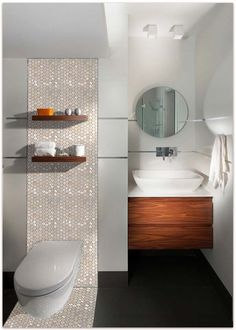 Love this look for behind the vanity and one side of the shower - also like the sink and  vanity but in white Mother of Pearl Hexagon accent tile on bathroom wall in this modern bathroom design! https://www.subwaytileoutlet.com/products/White-Hexagon-Pearl-Shell-Tile.html#.VOUIYvnF-1U