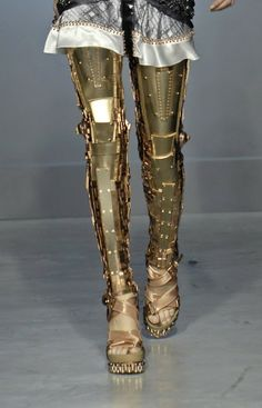 The Gilded Beetle: Metal Leggings and the Rise of Robotic Runways