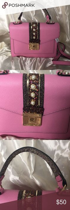 💕NWT ALDO Whisper Crossbody Bag BRAND NEW with Tag Aldo Whisper Crossbody Bag. Has long adjustable strap that's detachable. It is embellished with glitters and pearls. Exterior has one zip pocket and one slip front pocket, the interior has one zip pocket, and two open pockets. Can be used as a hand bag or crossbody bag! Get her now❤️ Aldo Bags Crossbody Bags