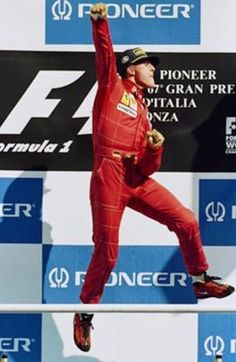 Michael Schumacher celebrates winning the 1996 Italian Grand Prix for Ferrari.