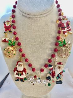 Christmas Red Vintage Santa Claus Believe Ornaments Rosary Bead Assemblage Upcycled Bib Necklace Doodaba Vintage Santa Claus, Vintage Santas, Red Christmas, Vintage Christmas, Christmas Necklace, Rosary Beads, Repurposed, Upcycle, Beaded Necklace