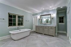 Floors, mirror, scones, tub