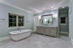 Floors, mirror, scones, tub