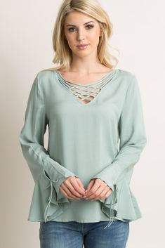 827d46da236 A solid hued top featuring a lightweight material