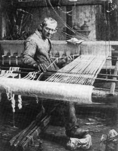 Weaver tying a new warp onto the end of the old one.