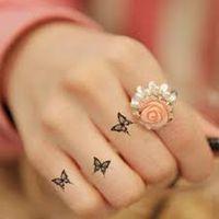 butterfly finger tattoo