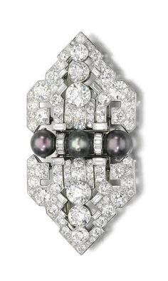 Natural pearl and diamond double clip brooch, Cartier, circa 1935 Composed of a pair of shield-shaped plaques of geometric design, set with circular-, single-cut and baguette diamonds