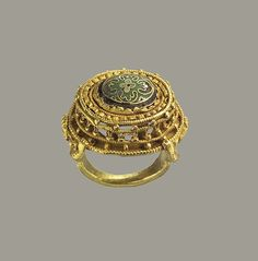 Ring, 10th-11th A.D., German. Gold with cloisonné enamel.The Metropolitan Museum of Art, New York. The Cloisters Collection, 2004 (2004.274). #ring #jewelry