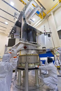 The OSIRIS-REx spacecraft core structure is successfully lowered and mated to the hydrazine propellant tank and boat tail assembly at Lockheed Martin, Denver, Colo.