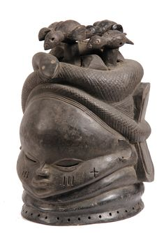 AFRICAN HELMET MASK - Mende Helmet Mask, 19th century, Liberia, for the senior woman in the Sande ritual, having four birds within coiled sn...