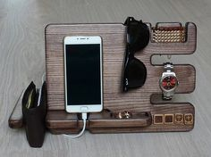 The docking station for smartphones, tablets, iphone, as well as a ragganger for watches, glasses, cuff links, keys, bracelets, jewelry, rings and more. Its handmade. Multi-functional and practical in use docking station. The docking station is made of natural wood: tree Ash. Covered with