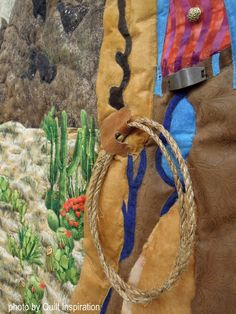 Code of the West by Roberta Simpkins. 2016 AZQG show. Closeup photo by Quilt Inspiration.