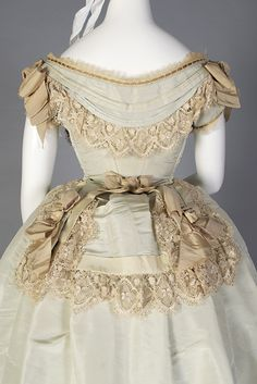 Pale green silk taffeta evening dress, American, ca. 1872, KSUM 1983.1.2145 a-c. This beautiful dress is currently on view in the Fashion Timeline!