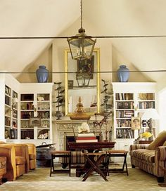 living room bookcases flanking fireplace and vaulted ceiling. #living_room #bookcases #vaulted_ceiling Richard Lambertson and John Truex's Connecticut country house featured in Elle Decor, 2008